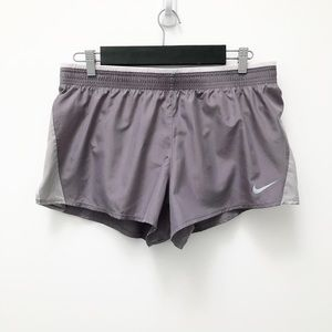 Nike standard fit grey and white running shorts.
